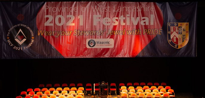 The stage is set, surmounted by the MCF 2021 Festival banner.