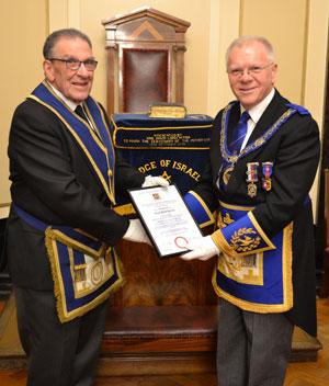 Louis Collins (left) receiving his 50-year certificate from Derek Parkinson.