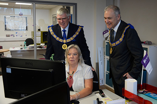 Tony Harrison (left) and Stephen Blank are shown some of the details by Hazel Russell, Head of Fundraising for Papyrus.