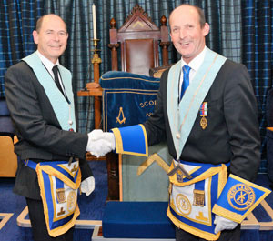 Harry Parker (right) congratulates Stephen Parker on attaining the master's chair.