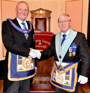 David Walmsley (left) congratulating Edward O'Hare.