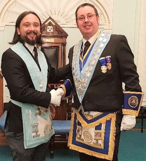Installing master and IPM Lee Ayres (left) with David Campbell.