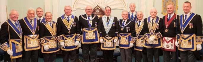 Pictured centre: David Campbell flanked by Phil Gunning (left), Derek Parkinson (right) and a plethora of grand and acting Provincial grand officers.