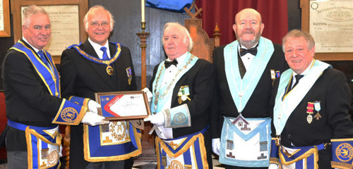 Pictured from left to right, at the presentation of the MCF 2021 Festival Vice Patron's Certificate are: Simon Hanson, David Ogden, Alan Herron, Terry Nealons and lodge charity steward Malcolm Hayward.