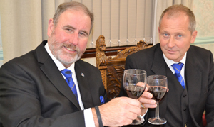Frank Umbers (left) taking wine with Anthony Gregg.
