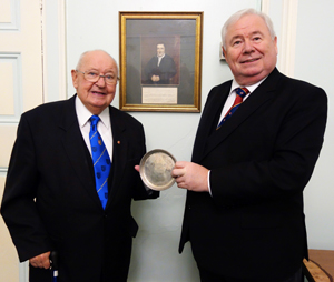 Bill Shuker (left) receives the silver salver from Peter Hegarty