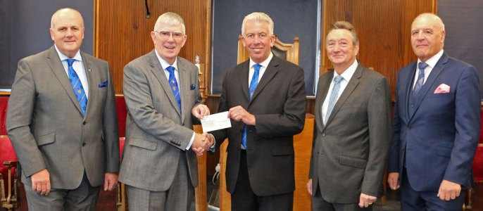 Pictured from left to right, are: David, Tony receiving the cheque from Mark with John and Steve alongside.