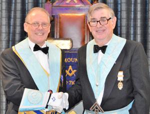 Ian Cuerden (left) being congratulated David Emery.