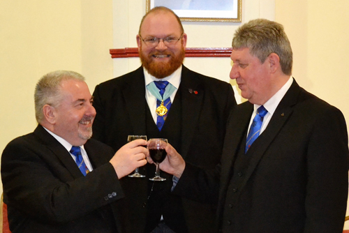 Chris Butterfield (left) toasts the new master Adrian Wells, with Andrew Ridal (centre) in attendance.