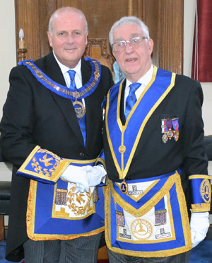 David winder (left) congratulates Doug Willoughby for his years of service as the DC of Lune Lodge.