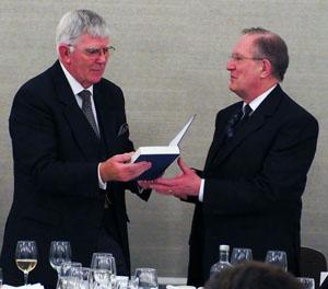 Tony Harrison (left) receives his memento from Graham Redman.
