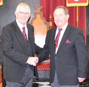 Tony Harrison (left) congratulates Stewart McVernon on his well-earned promotion.