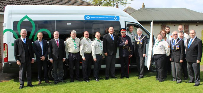 Tony Harrison is pictured with George Binns (driving seat), John Barnett MBE, scout leaders and Freemasons.