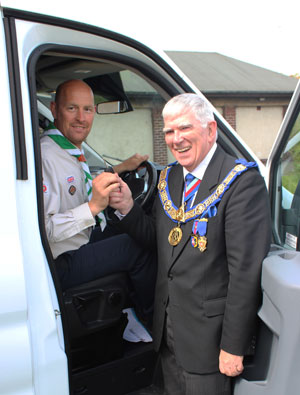 Tony Harrison hands the keys of the minibus to George Binns.