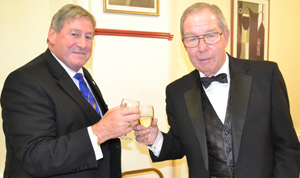 Neil McGill (left) congratulates Donald Polson on gaining the chair of Vale Lodge.