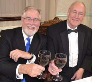 Phil Gardner (left) toasting the health of the new WM John Bates.