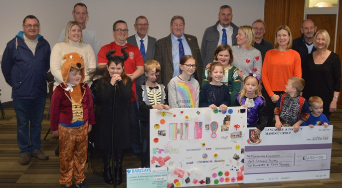 Lancaster and Morecambe Deaf Children's Society receive much needed donations from local Freemasons, whilst surrounded by children and parents from the charity.