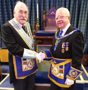 Keith Kemp (right) congratulating David Rhodes.