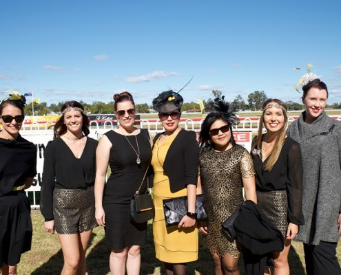 Racegoers getting into the spirit on Black & Gold Race Day