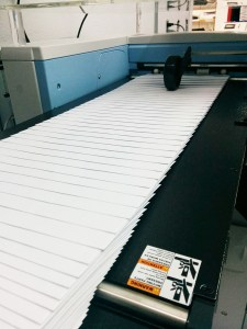 image of The New Digital Multi-Media Print System Busy Printing Envelopes at Westmount Signs & Printing