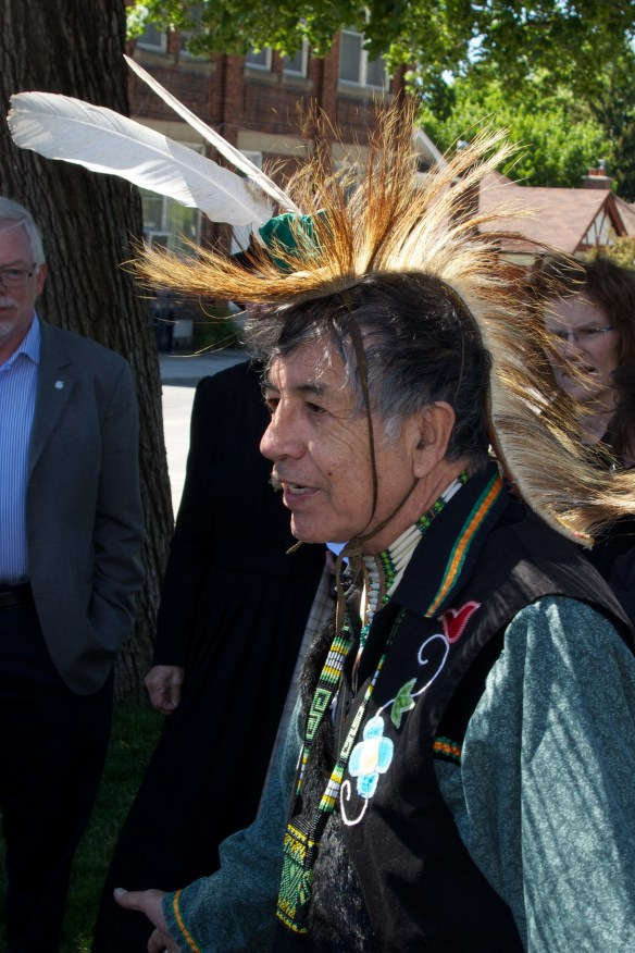 Elder Garry Sault of the Mississaugas of the New Credit First Nations leads a traditional Aboriginal blessing with smudging and drumming.