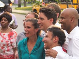 Trudeau posing with Hussen