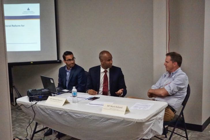 MP Ahmed Hussen (centre) and MP Mark Holland (right) discuss electoral reform with constituents.