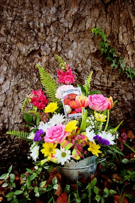 Bright, colorful mix of seasonal flowers in a rustic, tin pail. $49.95