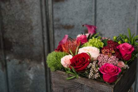 $100. A bundle of farm fresh, vivid blooms in a stained wooden box