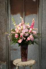 $65 powdery pinks with soft accents in a raspberry glass vase