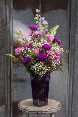 $75. Collection of gorgeous purples and lavenders in a violet colored vase