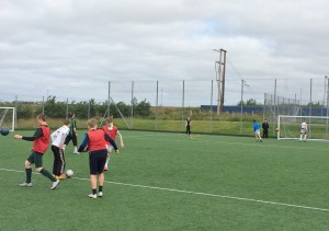 The Secondary age group taking part in a passing & shooting drill.