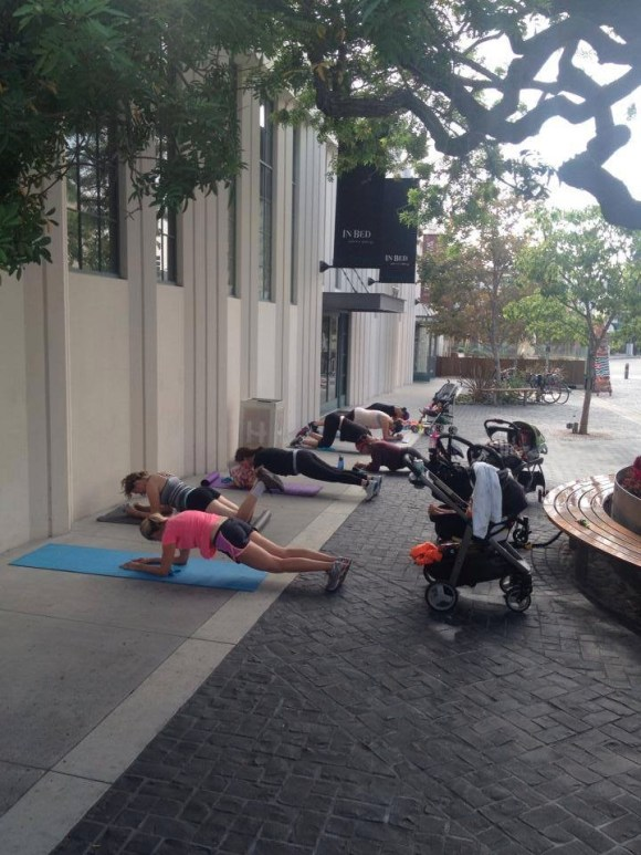 Planks during Baby Boot Camp at the Helms Bakery location