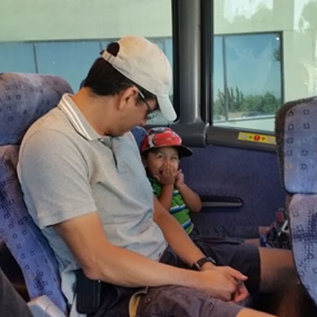 Toddler excited about riding the bus