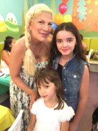 With Tori Spelling