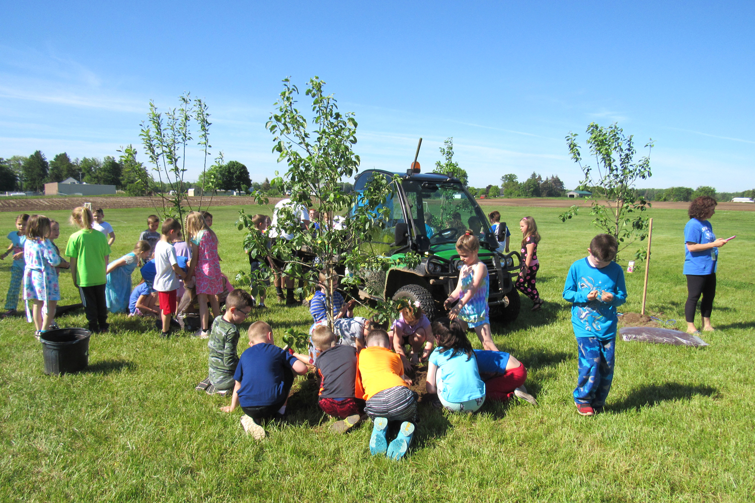 Elementary Students Plant School Orchard In Kendall