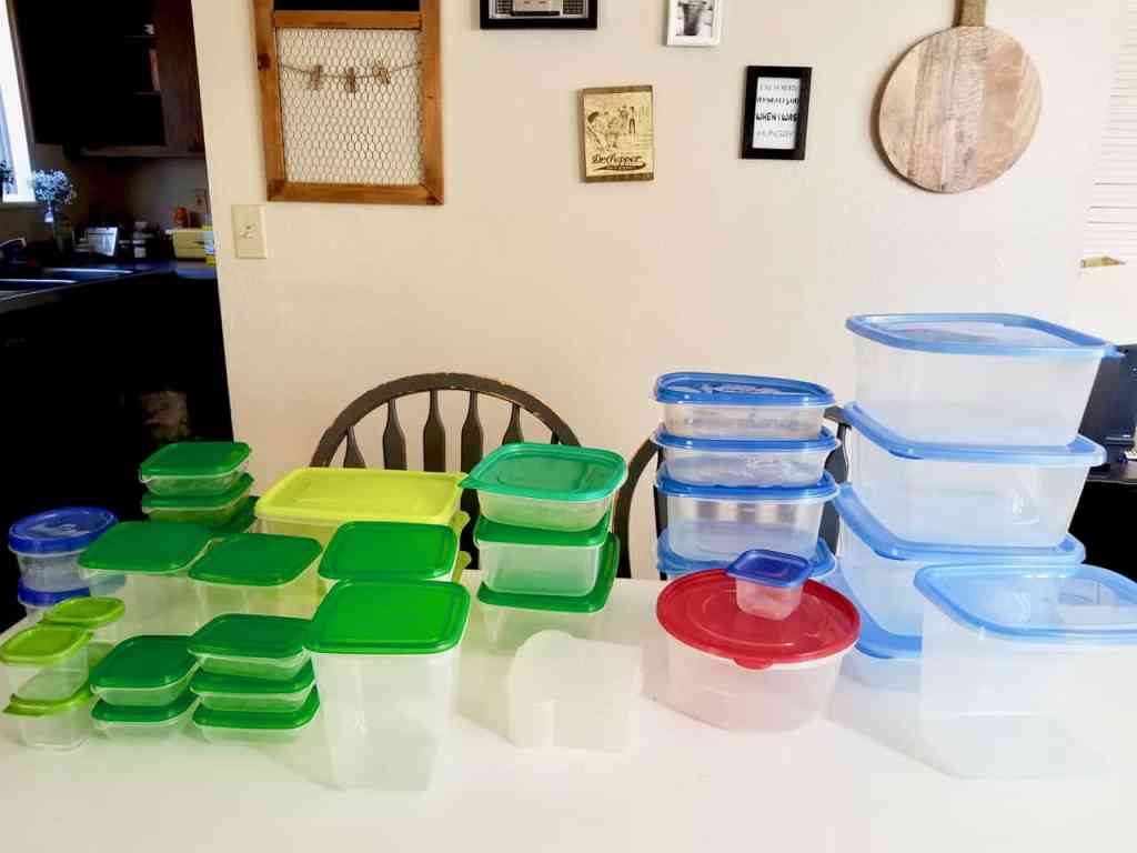 Is your tupperware storage a hot mess? How does it get unorganized so quickly? Keep reading to find 4 simple steps to get it back on track in less than 20 mins! | We Three Shanes