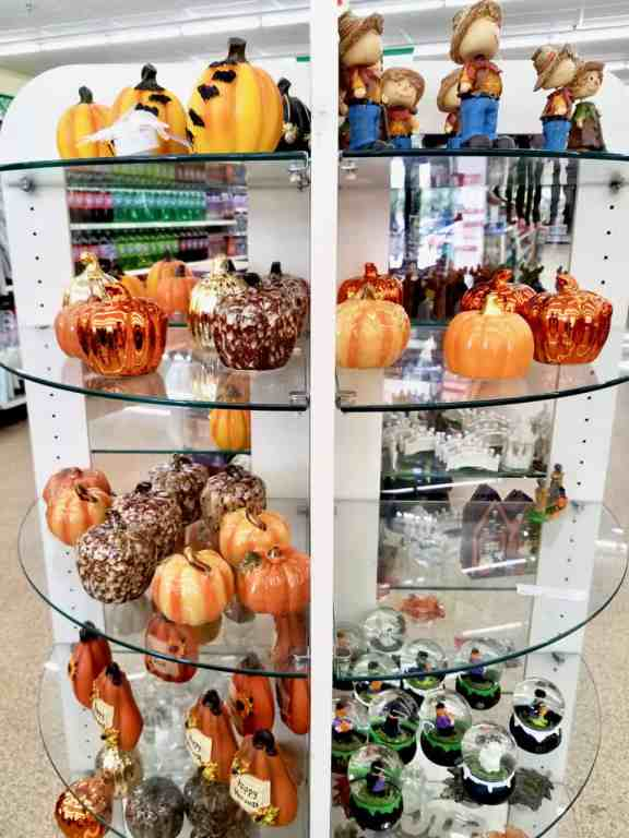 The dollar store always has the best pumpkin decor. These small ceramaic pumpkins look great on a mantel.