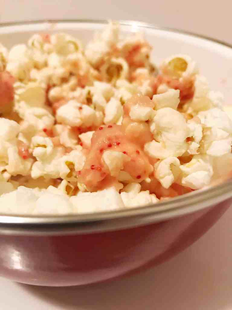 3 ingredients is all you need to make The Easiest White Chocolate Peppermint Popcorn. This heavenly holiday treat comes together in seconds with no crushed candy canes in sight! It's a lazy gals dream.   We Three Shanes