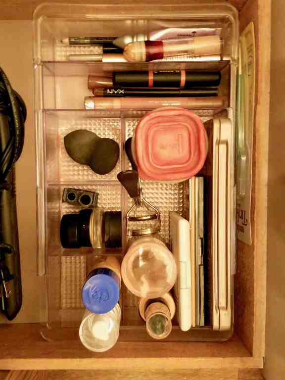 Learn how to downsize your makeup collection to just the essential with this easy to follow, step by step guide and helpful photos. Minimize makeup for better beauty routine. | We Three Shanes