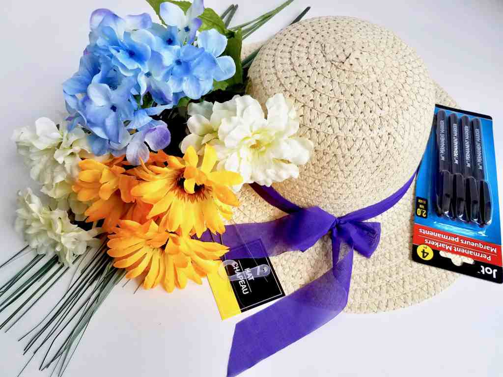 A wreath is an easy way to add character to your front porch. This inexpensive DIY Dollar Tree Sun Hat Wreath is perfect Spring and Summer door decor and sets the mood for happy thoughts before entering the home. Put a smile on visitor's faces by making your own today! | We Three Shanes