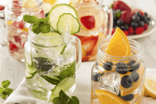 Summer Love Watermelon Mint Lemon Water is a refreshing way to stay hydrated this Summer. Check out this recipe and 16 other Flavored Water Recipes by clicking the link! | We Three Shanes