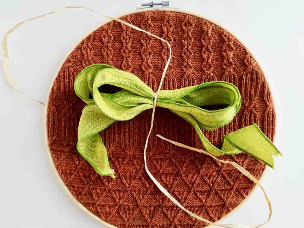 Create your own cozy DIY Pumpkin Hoop Wreath with this easy to follow tutorial. The perfect Fall decor for your wall or door. It's budget friendly and comes together in minutes.   We Three Shanes