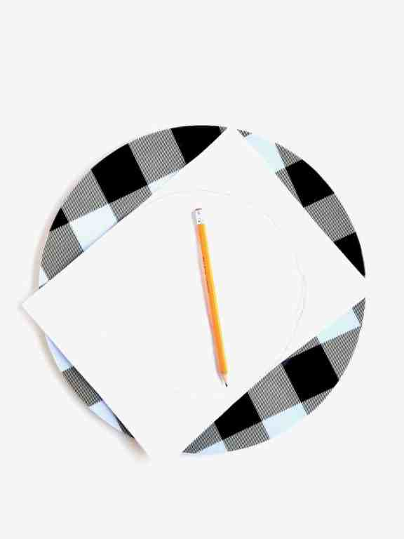 Use white paper to trace the inner circle of the charger plate to make a template. Use this template to cut out the calendar pages you want to use on your charger plate.