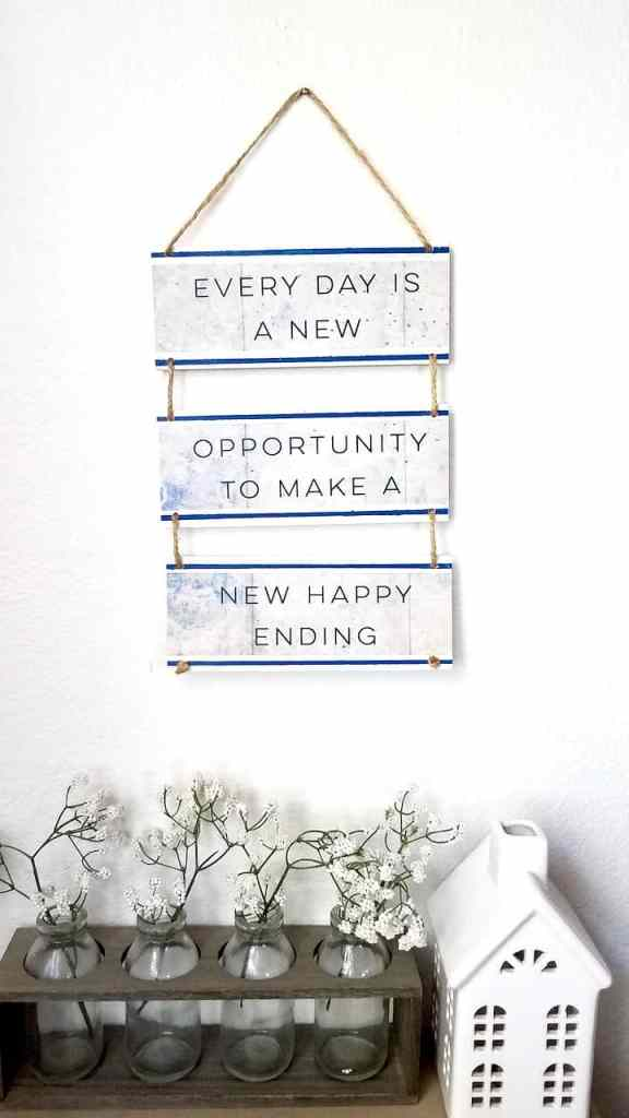A couple of wood slats and a Dollar Tree Calendar is all you need to make this uplifting quote sign! A super fun Dollar Tree DIY. | We Three Shanes