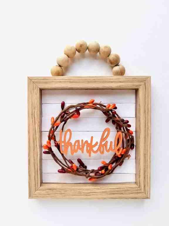Make this adorable farmhouse wood Bead sign using Dollar Tree supplies. | We Three Shanes