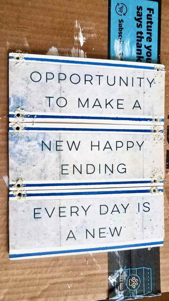 "Anyone can make this cute wood pallet quote sign. "" Every day is a new Opportunity to make a new happy ending."""