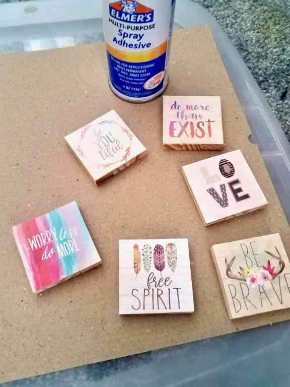 These Dollar Tree jenga wood blocks are glued together to make the cutest magnets using the squares from the backs of calendars. | We Three Shanes
