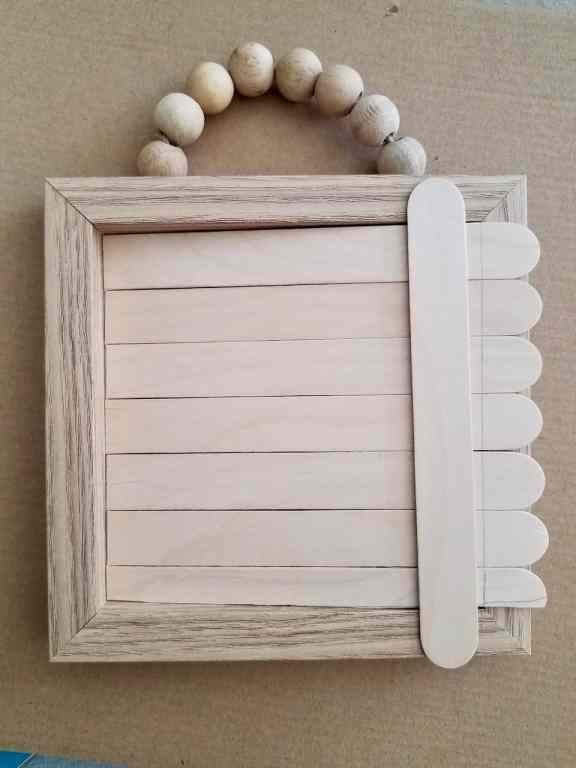 Transform a Dollar Tree Wood Bead Sign into a cute farmhouse frame for all the holidays. | We Three Shanes
