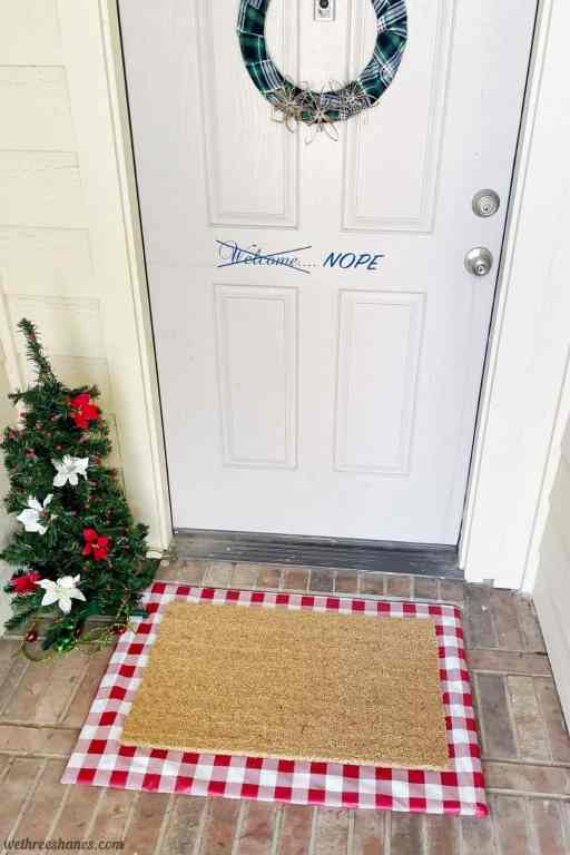 Make your own Interchangeable Layered Doormat for your front porch. It's an inexpensive way to add cute, seasonal decor to your front porch. | We Three Shanes